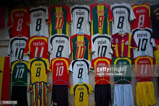 A local football shop selling replica shirts near the Agbogbloshie slum in Accra Ghana There are many young people in this area who play football and...