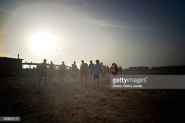 A local football team taking part in training on the main pitch in the Agbogbloshie slum in Accra Ghana There are many young people in this area who...