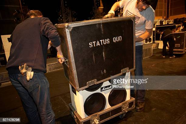 Local French stage hands assist Status Quo roadies to dismantle the stage and pack every item of equipment into the Band's crates for trucking onward...