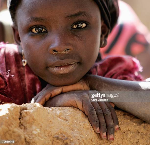 A local girl poses for the camera in Dawakin Kudu village on November 29 2006 near Freetown Sierra Leone The village is famous for the indigo...