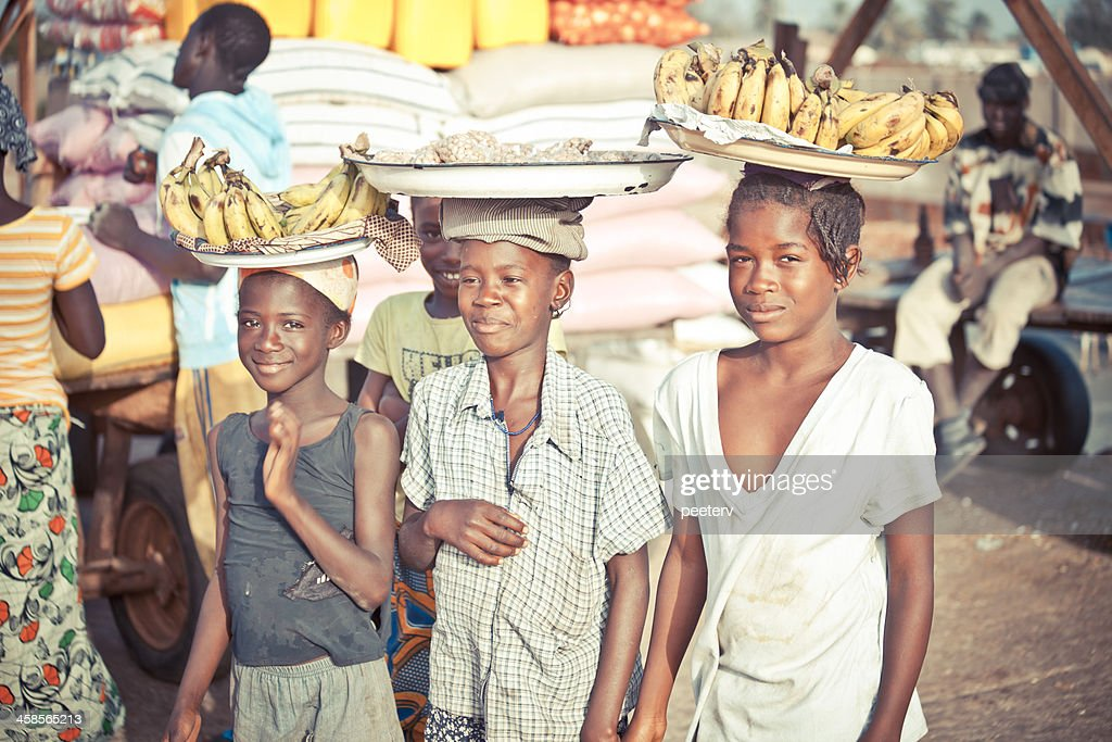 Local girls selling bananas. : Stock Photo