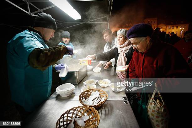 Local government along with Catholic relief organization Caritas have been giving out free food warm dishes and deserts for needy individuals and...