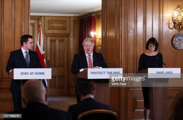 Local Government Secretary Robert Jenrick, Prime Minister Boris Johnson and Deputy Chief Medical Officer Jenny Harries give a daily COVID 19 press...