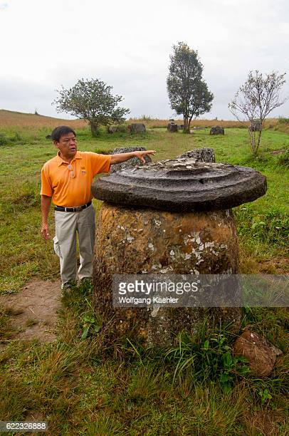 A local guide at the Plain of Jars which consists of thousands of stone jars scattered around the upland valleys and the lower foothills of the...