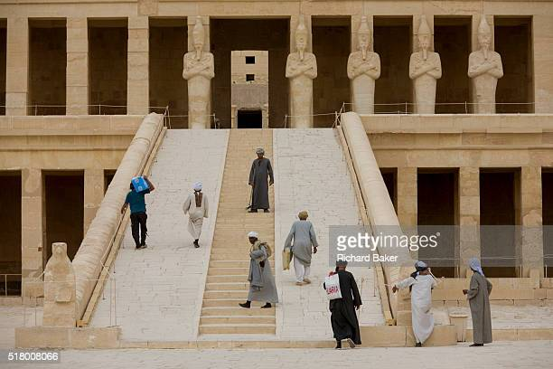 Local guides and caretakers on the steps at the otherwise deserted ancient Egyptian Temple of Hatshepsut near the Valley of the Kings Luxor Nile...