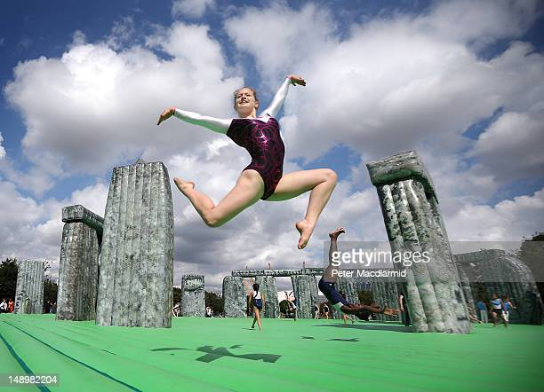 Local gymnasts enjoy an inflatable version of Stonehenge at the Greenwich Peninsula on July 21 2012 in London England The work known as 'Sacrilege'...