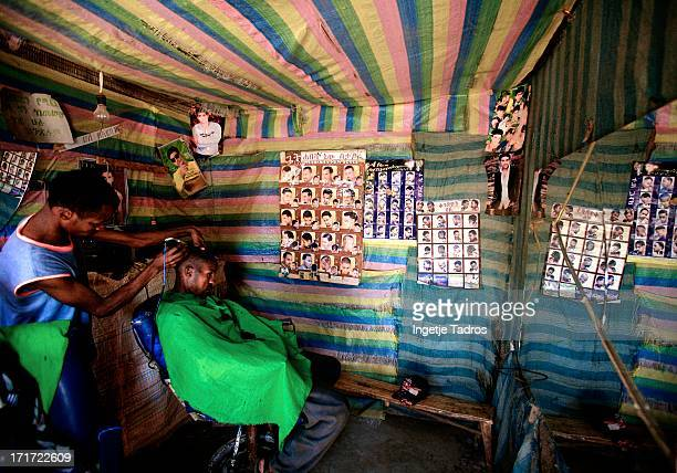 Local hairdresser in Sodo, as you can see on the walls are many examples of hairstyles, so you just have to pick one! Sodo,Ethiopia