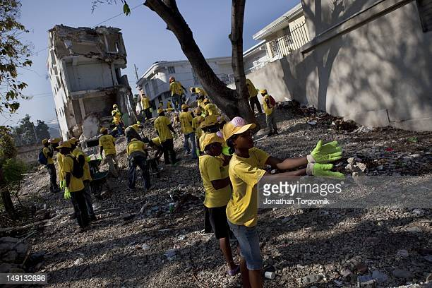 Local Haitian are hired with funds of USAID to help with the recovery efforts and remove rubble from buildings that were damaged during the...