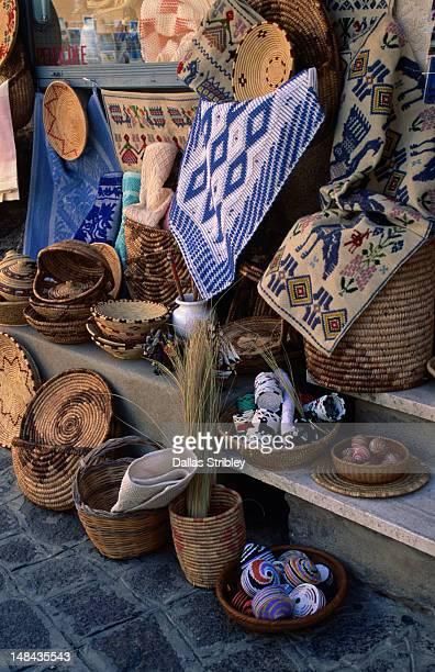 Local handicrafts, basketware and carpets for sale in Castelsardo.