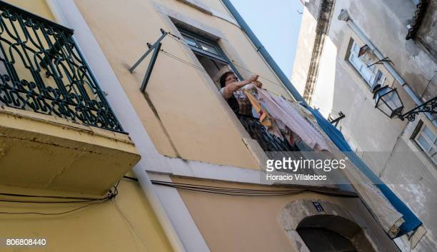 A local hangs clothes to dry near the castle in Bairro do Castelo neighborhood one of the city's oldest district and a favorite for foreign tourists...