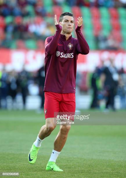 Local hero Portugal's forward Cristiano Ronaldo returns to his home town for the first time with the national team jersey during warm up before the...