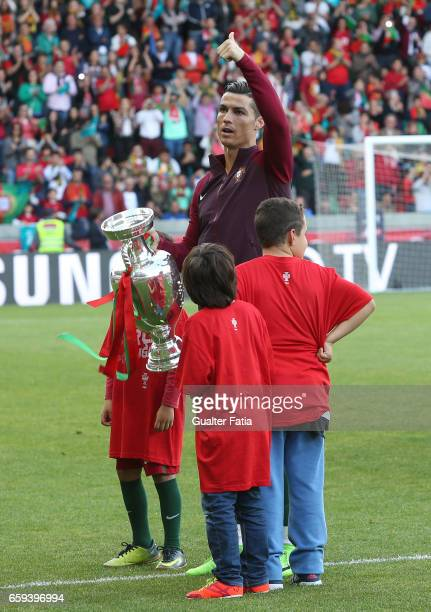 Local hero Portugal's forward Cristiano Ronaldo returns to his home town for the first time with the national team jersey with European Champion...