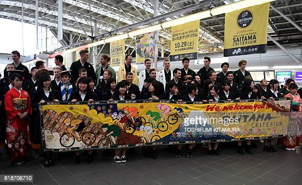 Local high school students welcome cyclists wearing Japanese Kimonos at an event during the 2016 Tour de France Saitama Criterium in Saitama on...