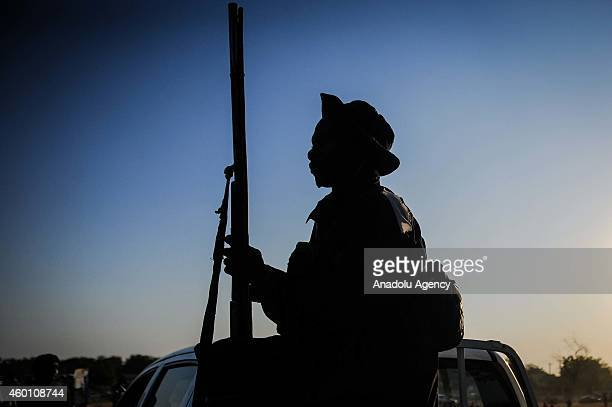 Local hunter known as Vigilante armed with locally made gun is seen on a pick up truck in Yola city of Adamawa State in Nigeria before he moves to...