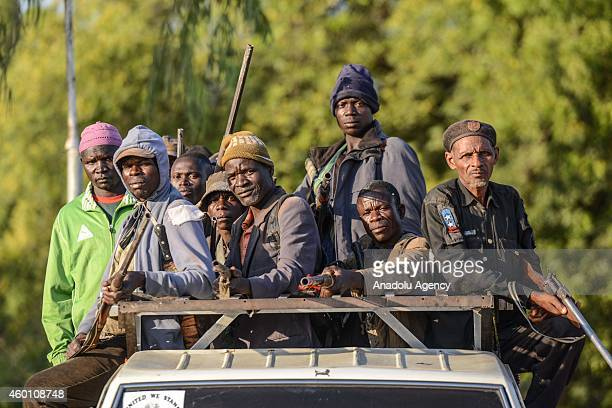Local hunters known as Vigilantes armed with locally made guns are seen on a pick up truck in Yola city of Adamawa State in Nigeria before they move...