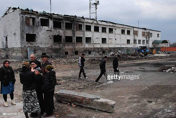 Local Ingush people have a conversation in Nazran on March 30 2010 while standing near the remains of the police compound that was attacked on August...