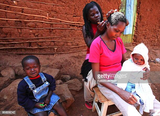 Local inhabitants coming together for hairstyling in Kibera Slum on March 20 2009 in Nairobi Kenya The Kibera Slum is home of more than 1 million...