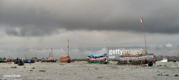 Local Intha tribes tow the royal barge on which four Buddha images are carried during the Phaung-daw-oo Pagoda Festival in Inle Lake in Shan State....