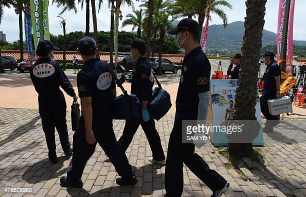 Local investigators arrive at the water park in Pali district in New Taipei City on June 28 2015 More than 500 people were injured almost 200 of them...