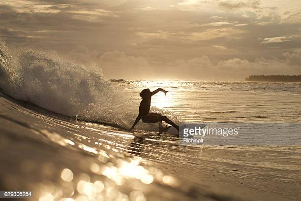 Local island surfer on a wave