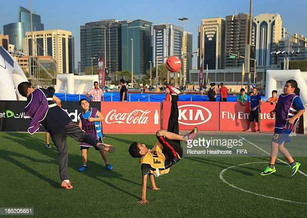 Local kids play 5aside football at the FIFA U17 World Cup UAE 2013 Fan Park on the Corniche on October 18 2013 in Abu Dhabi United Arab Emirates