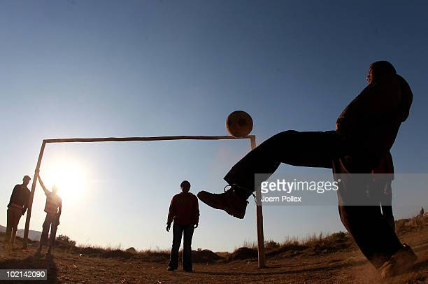 Local kids play football in a township on June 16 2010 in Pretoria South Africa