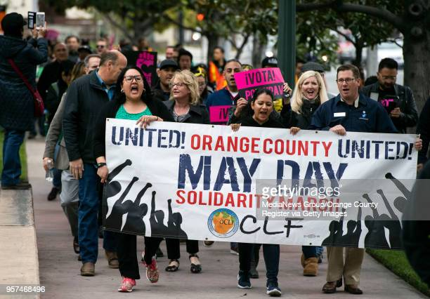 Local labor supporters march on May Day to a press conference where the Anaheim Union Coalition delivered 22000 signatures on petitions to qualify an...