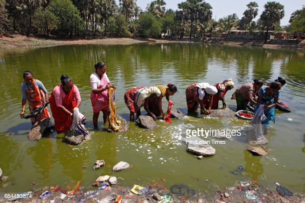 Local ladies wash their clothes in a small pond at Gorai village Borivli
