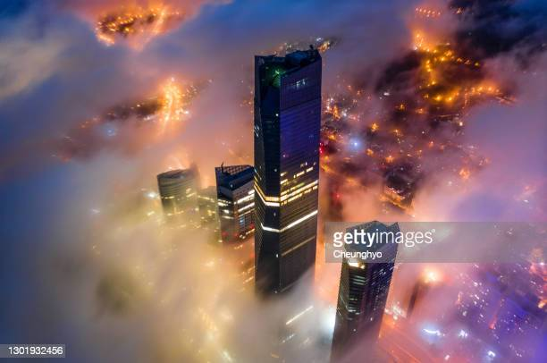 local landmark of qingdao cityscape in the mist, qingdao city, shandong province, china - luogo d'interesse locale foto e immagini stock