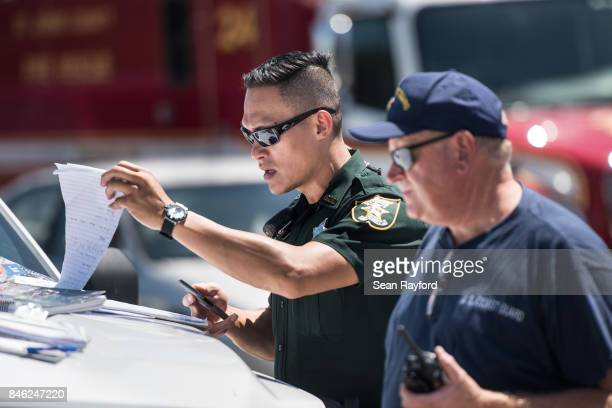 Local law enforcement looks over traffic operations needed after Hurricane Irma September 12 2017 in Middleburg Florida United States The storm...