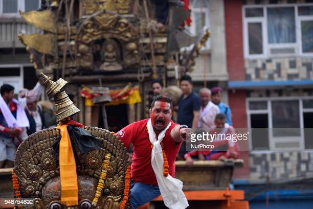 A Local leader on the chariot leads to pull Chariot of Rato Machindranath 'God of Rain' on first day at Pulchowk Lalitpur Nepal on Thursday April 19...