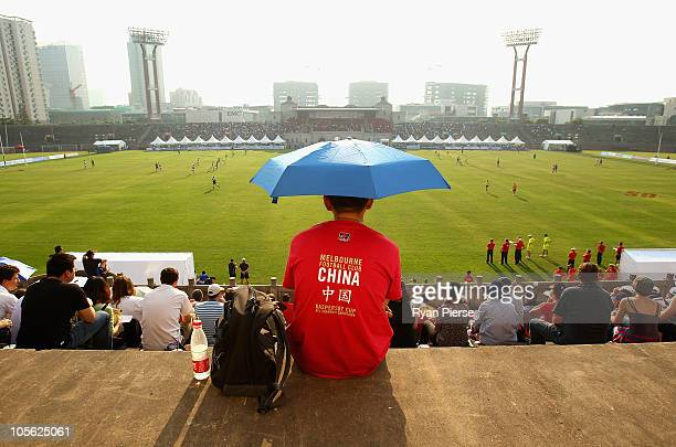 A local looks on during the AFL Kaspersky Cup Shanghai Showdown match between the Brisbane Lions and the Melbourne Demons at Jiangwan Sports Centre...