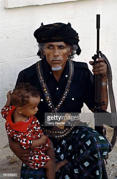 Local man and child in Salalah, Oman, 1982.