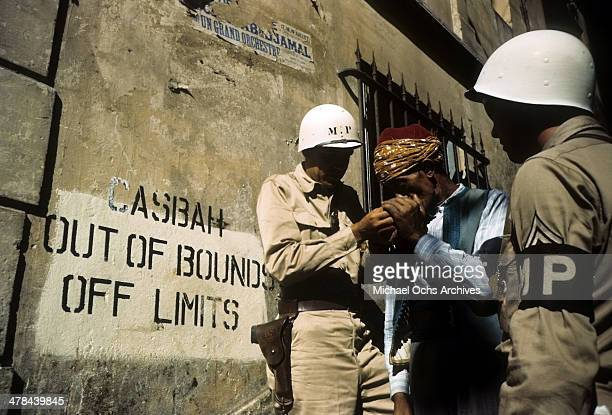 A local man gets a light in the Casbah of Algiers Algeria Off limits to US servicemen and patrolled by Military Police French and Algerian Police