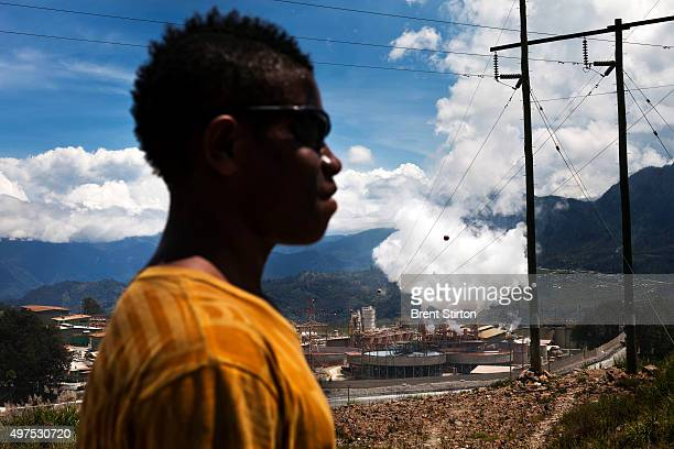 A local man outside the entrance to the Porgera Joint Venture Mine Papua New Guinea 23 November 2010 Local landowners sold their land to the mine for...