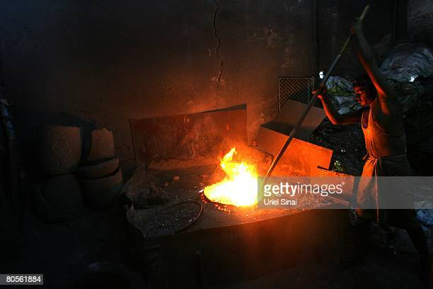 A Local man recycles aluminium at the Dharavi slum said to be 'Asia's largest slum' April 2008 in Mumbai India A city redevelopment program to...