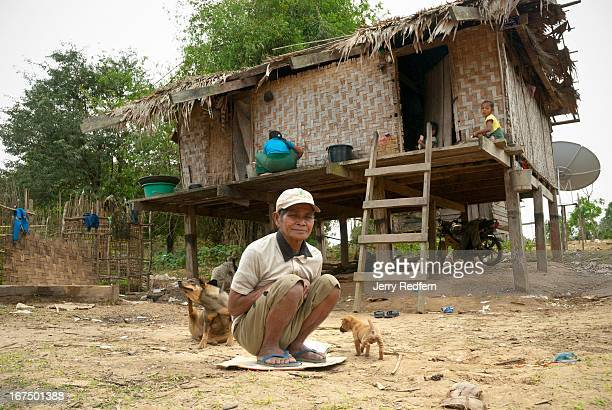 A local man sits on the spot where some sort of small explosive blew up underneath the village fire injuring several people the previous year Little...