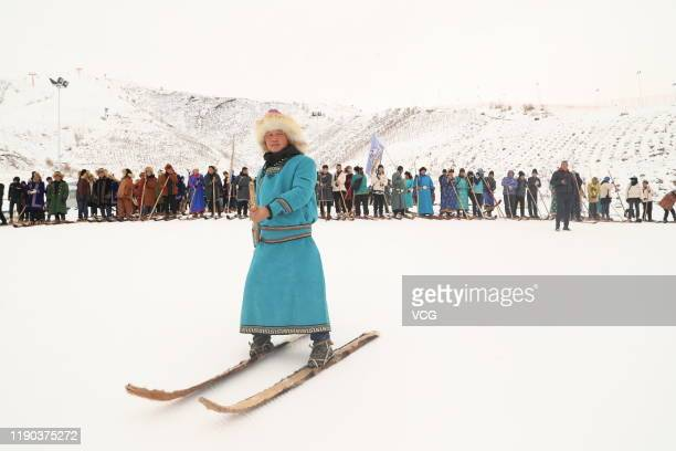 A local man skis with ancient fur skis at a ski resort on November 27 2019 in Altay Xinjiang Uyghur Autonomous Region of China The fur snowboard are...