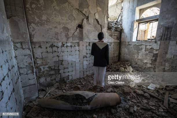 A local man stands next to a missile casing in a former government building The building was attacked in April 2015 Since the conflict escalated two...