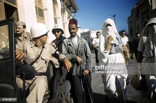 A local man talks with a MP in the Casbah of Algiers Algeria Off limits to US servicemen and patrolled by Military Police French and Algerian Police