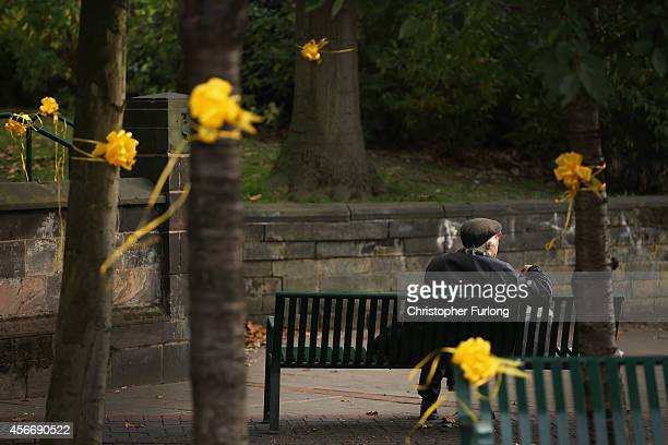 A local man waits for 'service of reflection' to begin for murdered aid volunteer Alan Henning at Eccles Parish Church on October 5 2014 in Salford...