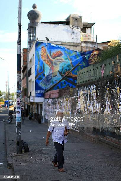 Local man walks in the old town area ahead of the FIFA Futsal World Cup on September 7, 2016 in Cali, Colombia.
