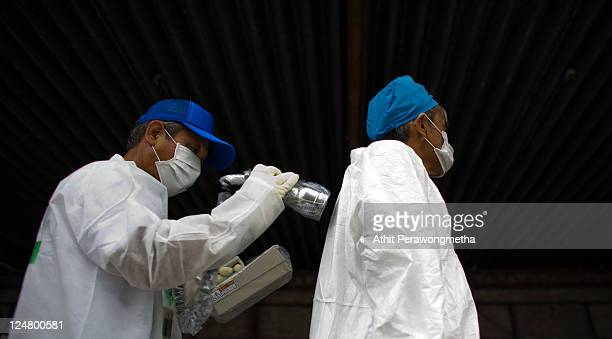 A local man who lived around the 20km exclusion zone around the Fukushima DaiIchi Nuclear Power Plant undergo a screening test for possible radiation...