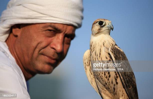 A local man with his Falcon at the FIFA U17 World Cup UAE 2013 Fan Park on the Corniche on October 18 2013 in Abu Dhabi United Arab Emirates