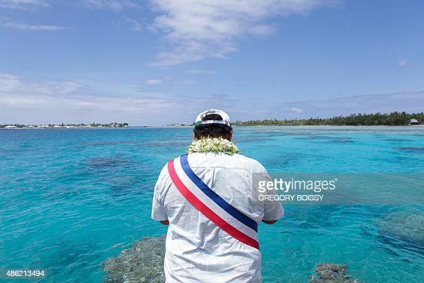 A local mayor stands in front of a lagoon on the Maupiti island on March 10 2015 In 2010 the mayor of a French Polynesia atoll worried by the rising...
