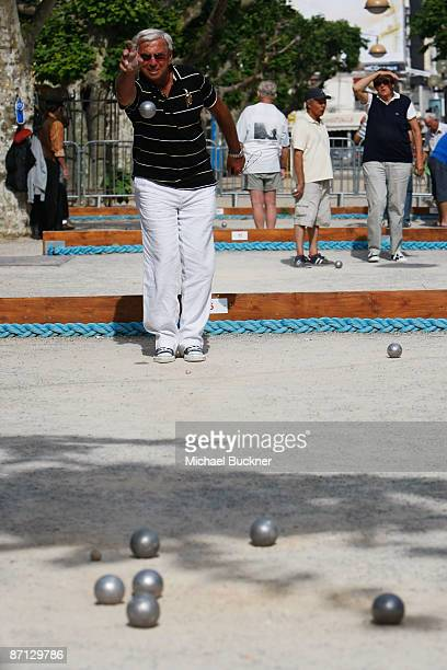 Local men play petanque prior to the start of the 62nd Cannes Film Festival on May 12 2009 in Cannes France