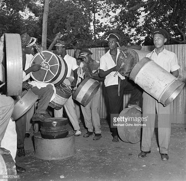 Local men play steal drums during a street carnival in Port of Spain Trinidad British West Indies