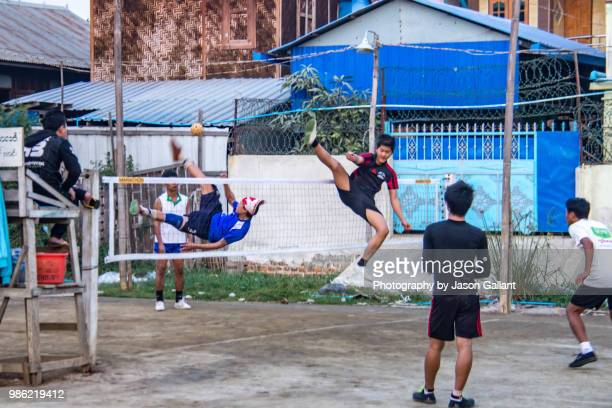 local men playing a game of chinlone in mandalay, myanmar. - kickball stock photos and pictures