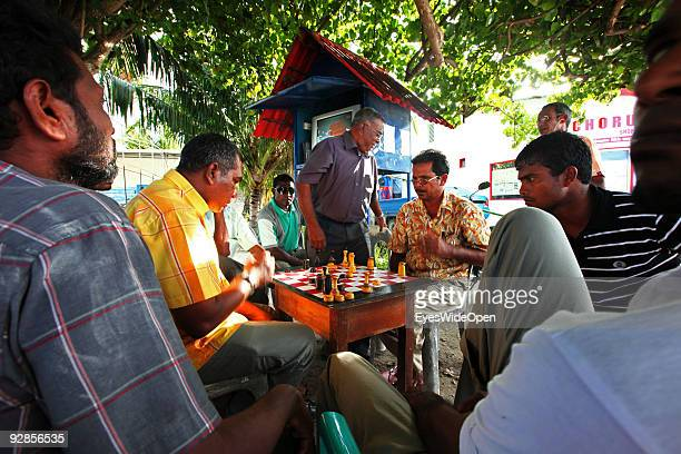 Local men playing chess on a central place and meeting point with television for everyone in a village on September 27 2009 on Fedu Island...