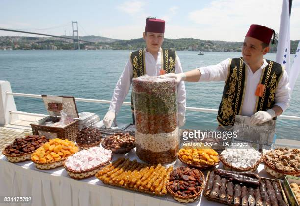 Local men sell snacks during the Queen's visit to Kabatas school in Istanbul on the third day of Their Royal Highnesses visit to the Republic of...
